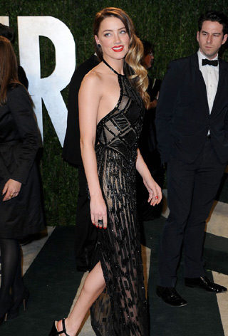 Amber Heard at the Vanity Fair Oscars party wearing an Adeler onyx and diamond ring