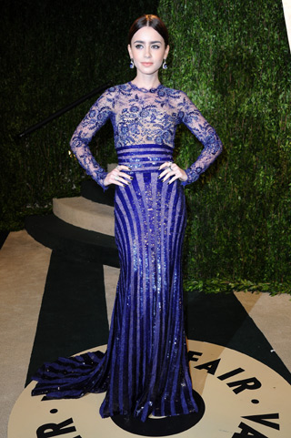 Lily Collins wearing an Adeler sapphire and diamond ring at the Oscars